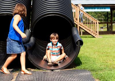 Boy goes down slide at Thompson farm