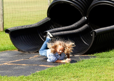 Students plays on slide at Thompson nursery