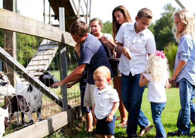 Students feed goats at Thompson Farm