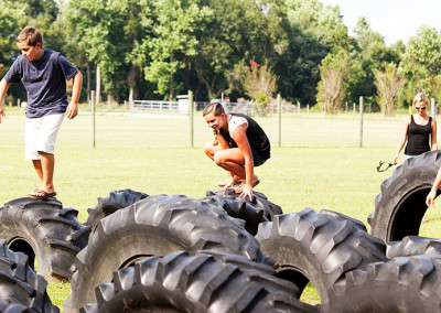 Kids play on giant tires at the farm