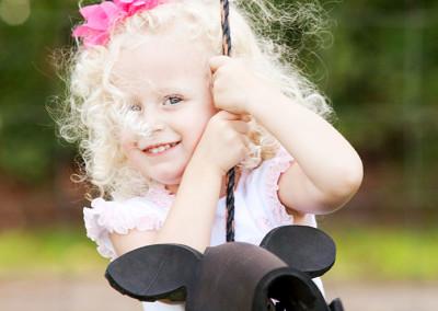 Child plays on swing at Nursery
