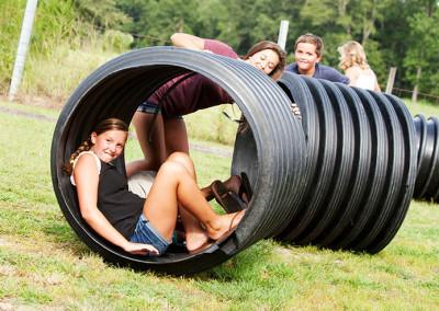Students play on the farm