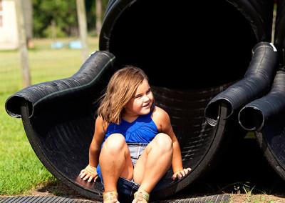 Girl plays on slide at Thompson Nursery